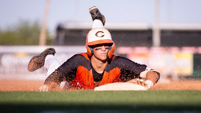 Junior infielder Hunter Haas (7) of the Corona del Sol Aztecs steals third base during the 6A state playoffs against the Desert Vista Thunder at Tempe Diablo Stadium on Tuesday, April 30, 2019 in Tempe, Arizona.