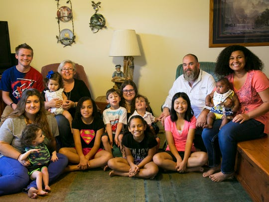 The Hamiltons have adopted 13 children and have two