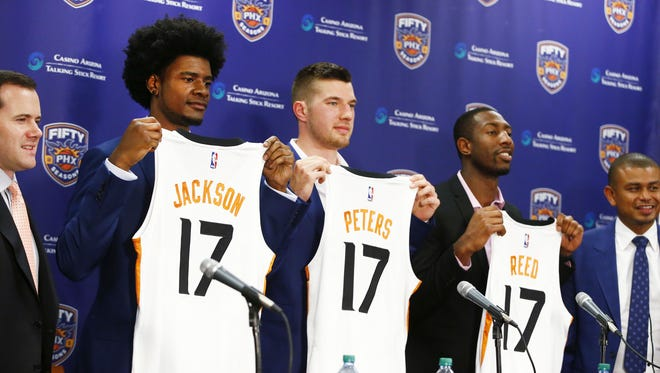 Josh Jackson, Alec Peters and Davon Reed (right) show-off their new Phoenix Suns jersey during a press conference on Jun. 23, 2017 at at Talking Stick Resort Arena in Phoenix, Ariz. Jackson, the Kansas forward was selected by the Suns with the fourth overall pick in the first round of the 2017 NBA Draft.