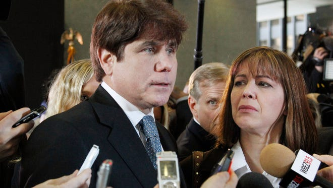 In this Dec. 7, 2011, file photo, former Illinois governor Rod Blagojevich speaks to reporters after he was sentenced to 14 years in prison.