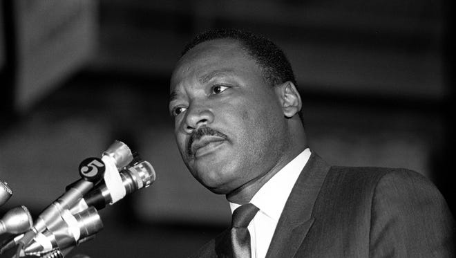"Dr. Martin Luther King Jr., who was on a tour of the South to recruit volunteers for his ""Poor People's Campaign"", spoke to an overflow crowd at Mason Temple March 18, 1968. Crowd estimates ranged from 9,000-13,000. Speaking in support of striking sanitation workers, King called for a general work stoppage by black Memphians if the city did not agree to a union dues checkoff. ""Along with wages and other securities, you're struggling for the right to organize. This is the way to gain power. Don't go back to work until all your demands are met"", Dr. King told the crowd. He pledged to return to Memphis on March 22 to lead a march that was postponed because of a near record snowfall. The protest was rescheduled for March 28. The march ended in disorder with looting and vandalism along Beale and Main Streets. Police moved in with tear gas and nightsticks. By day's end, one person had been killed and more than 60 injured. King would agonize over what happened and vowed to return to lead a peaceful mass march. On Wednesday, April 3, King again returned to Memphis. That night, more than 2,000 listened as he gave his famous ""Mountaintop"" speech at Mason Temple. The next day, at 6:01p.m., an assassin's bullet struck Dr. King as he stood on the balcony outside room 306 at the Lorraine Motel. (By Vernon Matthews / copyright, The Commercial Appeal)"