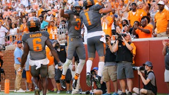 Tennessee Volunteers running back Jalen Hurd (1) and Tennessee Volunteers wide receiver Josh Malone (3) celebrate after Hurd scored a touchdown against the Florida Gators during the second quarter at Neyland Stadium.