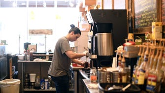 Alissa Vitale makes an iced coffee at Sogno Coffee House in Westwood.