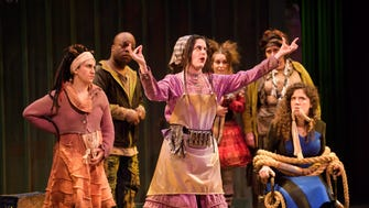 """Amber Smith (center) sings in Skylight Music Theatre's """"Urinetown."""""""