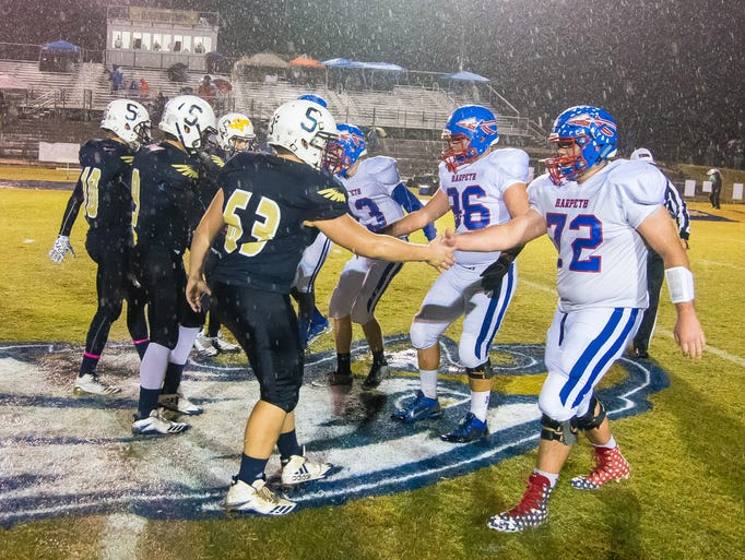 Sycamore and Harpeth team captains shake hands prior
