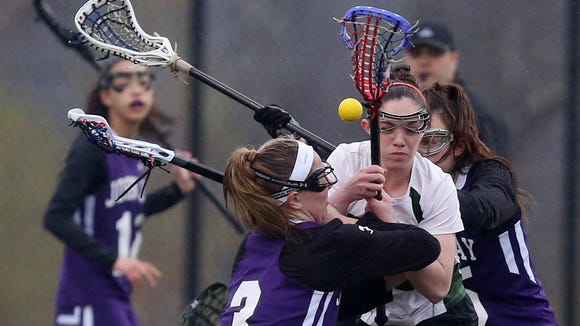 John Jay defeated Brewster 10-9 in girls lacrosse action at Brewster High School April 27, 2018.