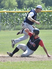 Maplewood's Jordan Jorgensen, top, collides with Kolberg runner Eric Lardinois at second base during Door County League baseball on Sunday at Maplewood.