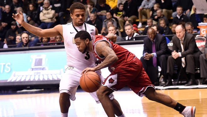Arkansas State Red Wolves guard P.J. Hardwick (5) tries to drive past Purdue Boilermakers guard P.J. Thompson (3) in the first half at Mackey Arena.