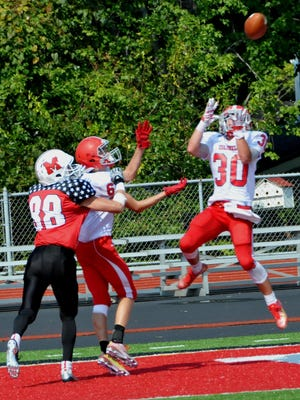The last pay of the first half was a pass intended for Milford's Brendan Dugan (88) but was picked off by the Colonels as Dixie's Zach Borchers (6) and Ethan Schulte (30) defended.