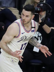 Sixer JJ Redick reacts after a thriee-pointer late in the second half of the Sixers' 104-91 win in game five of an opening round playoff series at the Wells Fargo Center in Philadelphia Tuesday.