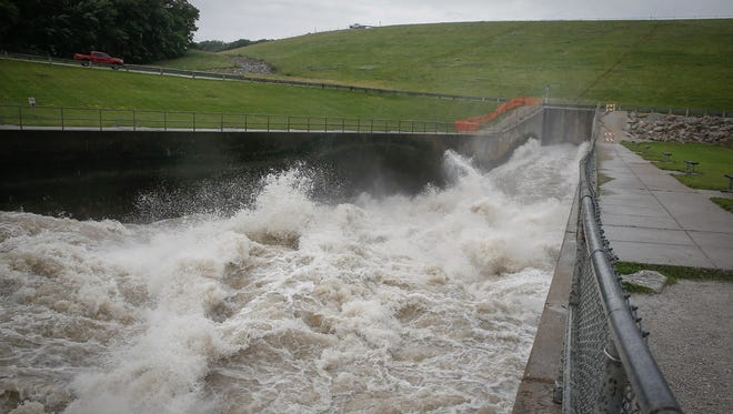 Water blasts through the Saylorville Dam and into the Des Moines River on Monday, June 25, 2018.