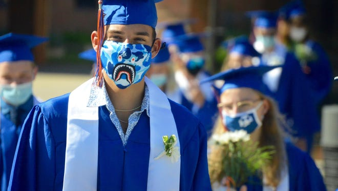 Saugatuck's Class of 2020 walks from the high school to the stadium for its commencement Sunday, Aug. 2. The commencement was originally scheduled for May 21, but COVID-19 required the event to be rescheduled.
