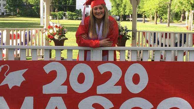 Masconomet Class of 2020 graduate Grace Rehak in the gazebo on Topsfield Common before the start of the Rolling Tribute Friday, May 29. The sign hanging at the gazebo was painted by Dan and Kim Philpot.