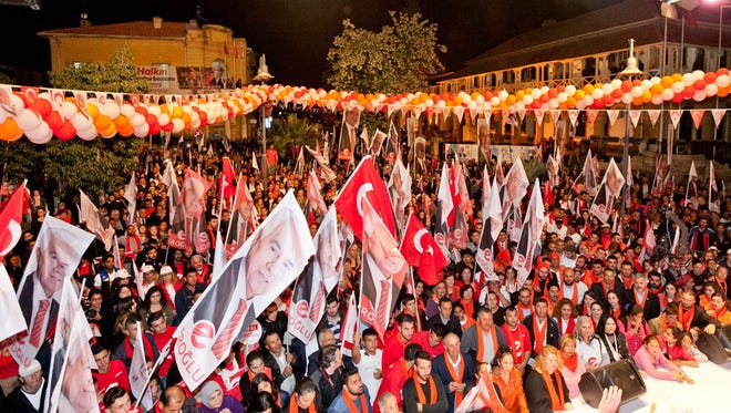 Supporters of Turkish Cypriot leader and presidential candidate Dervis Eroglu  wave the Turkish flag during a last campaign rally in the breakaway Turkish Republic of Northern Cyprus, in the Turkish-administered northern part of the divided capital Nicosia, Cyprus, 17 April 2015.