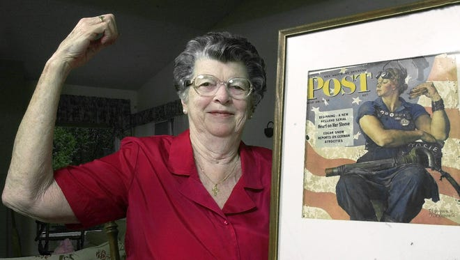 "Mary Doyle Keefe poses at her home in Nashua, N.H., with the May 29, 1943, cover of the Saturday Evening Post for which she had modeled as ""Rosie the Riveter"" in a Norman Rockwell painting."