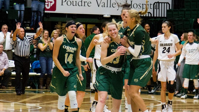 Colorado State players celebrate the game-winning shot by Ellen Nystrom (13) Wednesday evening at Moby Arena in Fort Collins. Nystrom stroked a jumper with 1.6 seconds left in the game to put CSU ahead of CU Boulder 64-63.