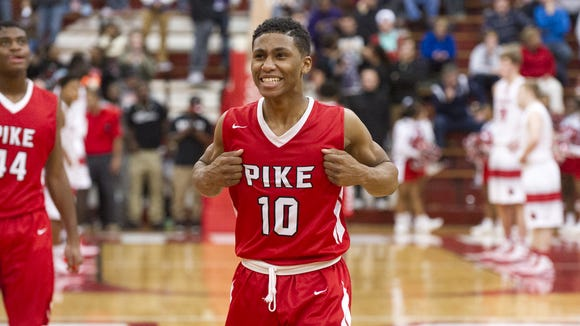 Pike High School sophomore Justin Roberts (10) reacts as the final seconds tick off the clock, clinching the Red Devil's victory over Southport in four overtime periods. Southport High School hosted two semi-final games of the 2015 Marion County Boys Basketball Tournament, Friday, Jan. 16, 2015. Pike defeated Southport 92-86 in four overtime periods.
