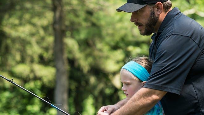 Howard Hodder and his daughter Lily, 6, of Mechaincsburg first together on Father's Day at Limestone Springs Preserve on Sunday, June 19, 2016.