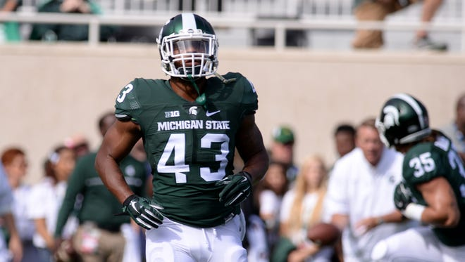 Michigan State Spartans linebacker Ed Davis runs drills before a game against Wisconsin on Sept. 24, 2016 at Spartan Stadium.