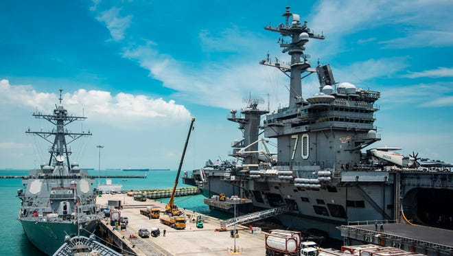 A U.S. carrier, missile destroyer and missile cruiser in Singapore on April 4, 2017.