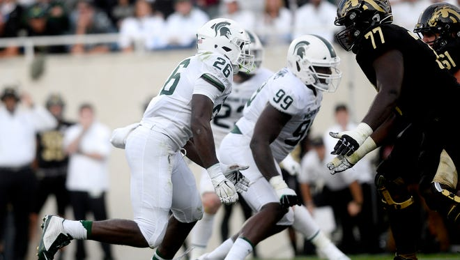 Michigan State's Brandon Randle (26) looks to get around Western Michigan tackle Chukwuma Okorafor (77) during the fourth quarter on Saturday, Sept. 9, 2017, at Spartan Stadium in East Lansing.