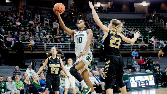 Michigan State's Branndais Agee, center, shoots between Oakland's Taylor Gleason, left, and Leah Somerfield during the fourth quarter on Monday, November 13, 2017, at the Breslin Center in East Lansing.