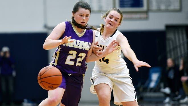 Haslett's Teagan Woodworth, right, pressures Fowlerville's Jackie Jarvis during the fourth quarter on Tuesday, Dec. 19 2017, at Haslett High School. Haslett won 51-49.