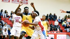 With basketball tournaments on horizon, Everett and Okemos filling a void in Lansing area