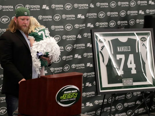 New York Jets center Nick Mangold, holding his 3-year-old