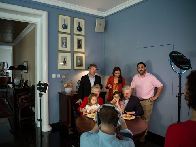The Branstad family is filmed while eating mooncakes