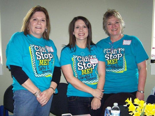 Dr. Mary Wren, left, joins Amanda Thornton and Corinne Hiser during a 2014 event promoting the Schliemann Center for Women's Health Education.