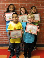 The Yucca Cool Cats from Yucca Elementary School stand with their awards from Gov. Susana Martinez.