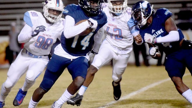 Airline's Coby McGee runs for a big gainer against Zachary Friday night in Bossier City.