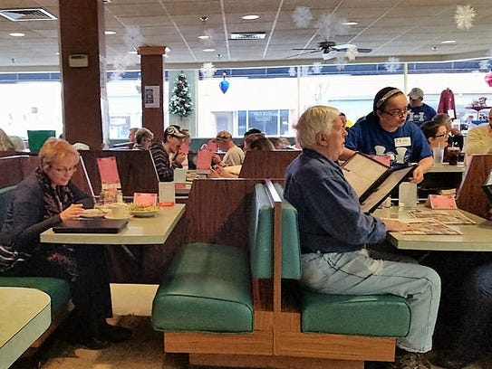 Neighbors gather in the familiar booths at Hinkle's