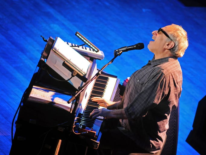 Donald Fagen plays the keyboard and belts out a tune as Steely Dan performs at the Ryman Auditorium in Nashville, Tenn., for their second show of a two night stand Saturday, August 2, 2014.