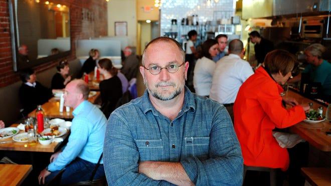 Bernard Malherbe, chef and owner of Kitchen on Court Street, is shown inside his Salem restaurant.