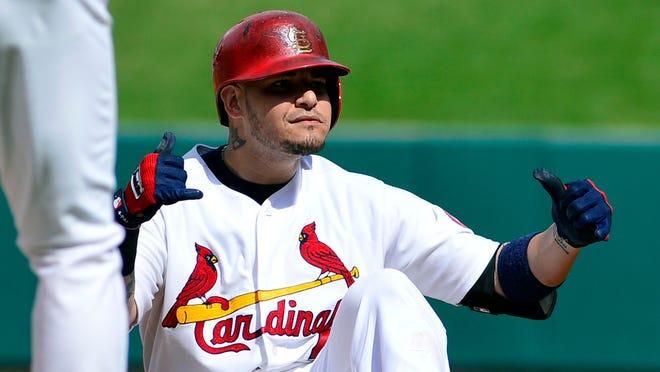 Cardinals catcher Yadier Molina celebrates his two-run single against the Washington Nationals on Wednesday.