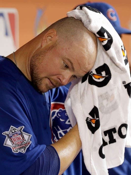 Chicago Cubs' Jon Lester cools off in the dugout in the fifth inning of a baseball game against the Miami Marlins, Thursday, June 23, 2016, in Miami. (AP Photo/Alan Diaz)
