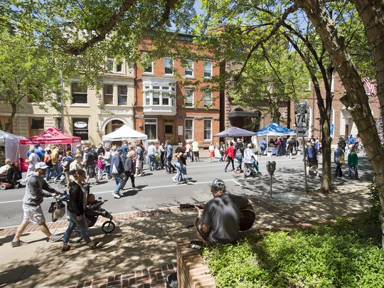 Downtown festivals, like the Mother's Day Street Fair, shown here, are not the key to fostering cultural diversity and interaction.