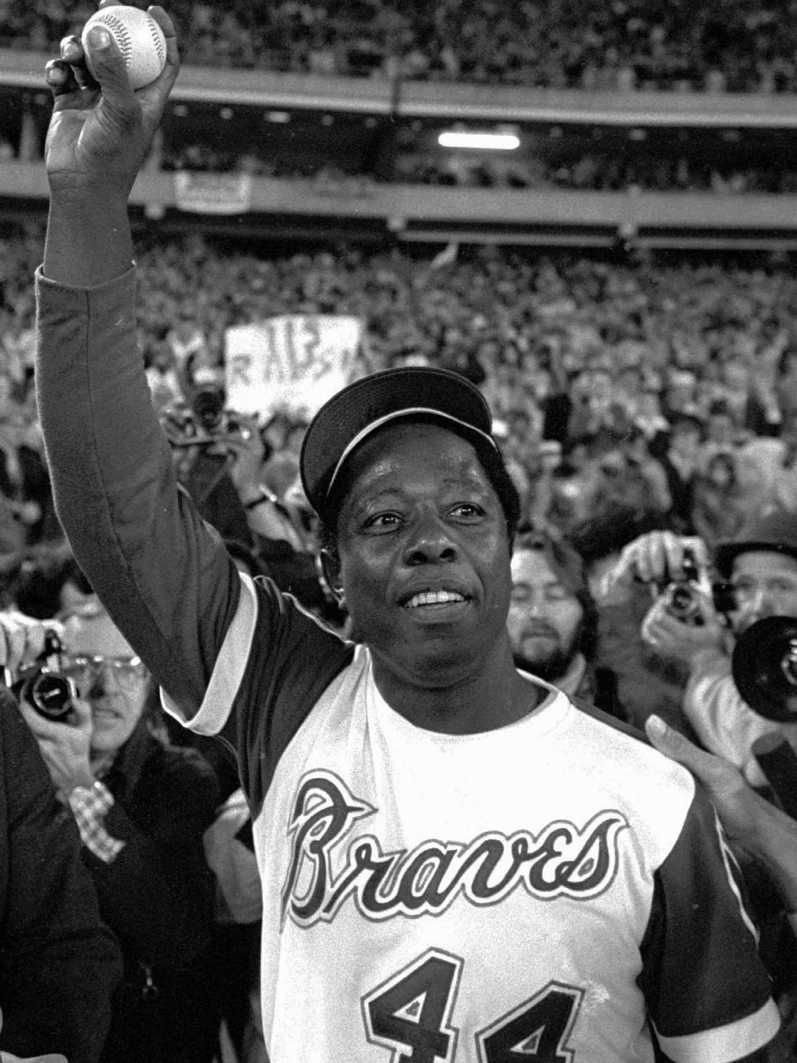 Hank Aaron shows off the baseball he hit for his record-breaking