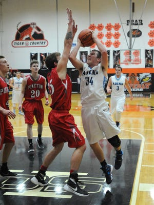 Adena's Isaac Thomas takes a shot over a Piketon defender Monday at Waverly's downtown gym.