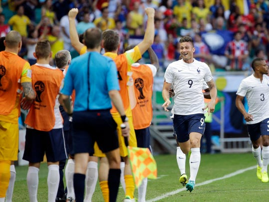 France's Olivier Giroud, second from right, celebrates after scoring the opening goal during the group E World Cup soccer match between Switzerland and France at the Arena Fonte Nova in Salvador, Brazil, Friday, June 20, 2014.  (AP Photo/Christophe Ena)