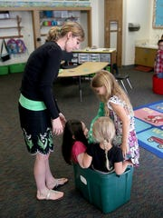 Olalla Elementary teacher Nicole Krueger works with students during a kindergarten boot camp class.