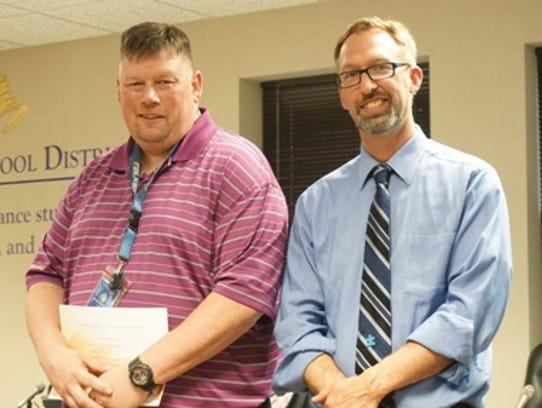 The Wausau School Board honored Randy Erdman and Ryan