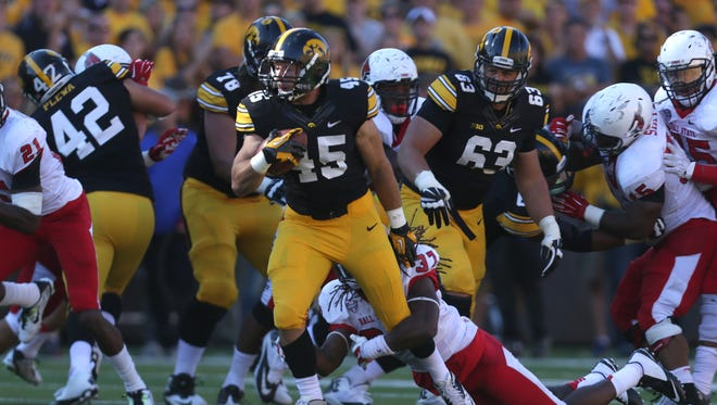 Iowa running back Mark Weisman moves the ball against Ball State on Saturday, Sept. 6, 2014, at Kinnick Stadium in Iowa City, Iowa.