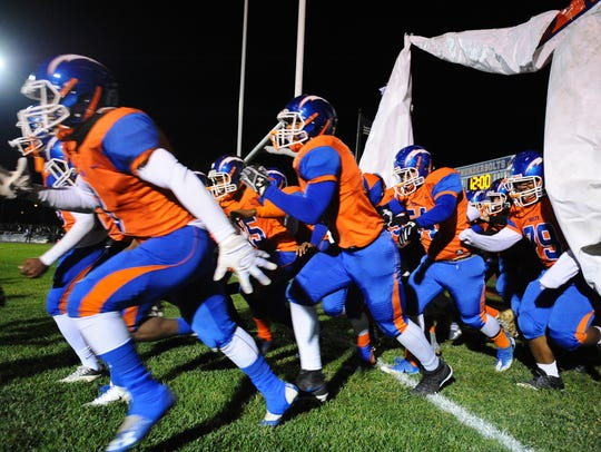 The Millville Thunderbolts enter the field before Friday's