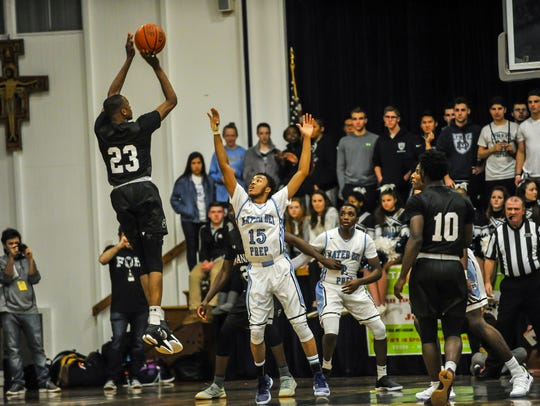 Scottie Lewis of  the Ranney School, launches a shot over Kenny Jones of Mater Dei Prep in a game on Feb. 5 in Middletown.