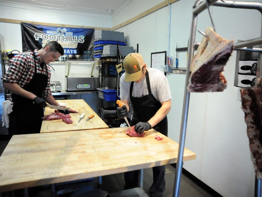 Foothills Local Meats executive chef David Kane, left,