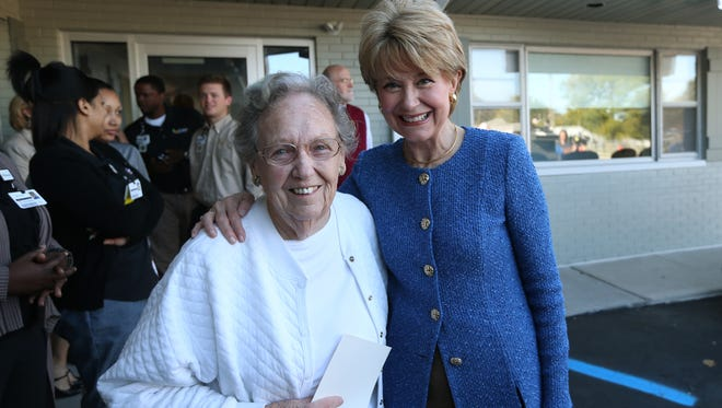 Jane Pauley has her photo taken with Sue King, 87, after King surprised her at Monday's grand opening of the 16th Street location of the Jane Pauley Community Health Center. King lived across the street from Pauley when she was growing up in Indianapolis. Pauley was on hand for the grand opening of the site at 5317 E. 16th St.