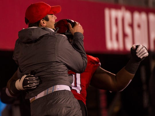 Head Coach Will Healy jumps into Theron Hodges's arms in the final minutes of their winning game against Eastern Illinois on November 18, 2017.